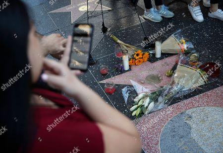 """People look at actor Kirk Douglas' star on the Hollywood Walk of Fame, in Los Angeles. Douglas, the muscular actor with the dimpled chin who starred in """"Spartacus,"""" """"Lust for Life"""" and dozens of other films and helped fatally weaken the Hollywood blacklist, died at 103, on Wednesday"""