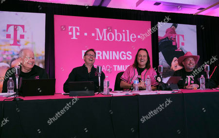Stock Picture of IMAGE DISTRIBUTED FOR T-MOBILE - T-Mobile executives including, from left, T-Mobile Chief Technology Officer Neville Ray, President and Chief Operating Officer Mike Sievert, CEO John Legere and CFO Braxton Carter share a laugh while reporting on record financial results during the T-Mobile Q4 and Full-Year 2019 Earnings Call on in Bellevue, Wash. Results included service revenues of $8.7 billion and total revenues of $11.9 billion. Executives also discussed the company's launch of America's first nationwide 5G network, covering more than 200 million people across the U.S