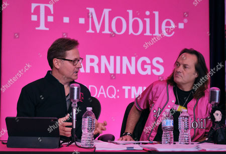 Stock Image of T-Mobile CEO John Legere, right, and President and COO, Mike Sievert answer caller questions during the Un-carrier Q4 and Full-Year 2019 Earnings call on in Bellevue, Wash