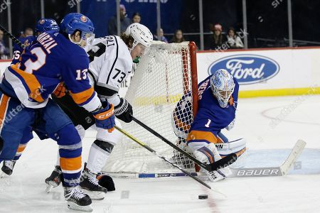 New York Islanders goaltender Thomas Greiss (1) stops a shot by Los Angeles Kings' Tyler Toffoli (73) as Mathew Barzal (13) defends during the third period of an NHL hockey game, in New York. The Islanders won 5-3