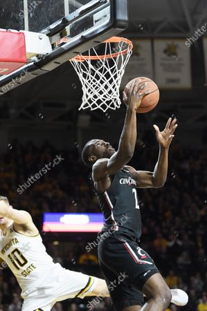 Stock Image of Cincinnati Bearcats guard Keith Williams (2) scores off a reverse layup during the NCAA Basketball Game between the Cincinnati Bearcats and the Wichita State Shockers at Charles Koch Arena in Wichita,Kansas
