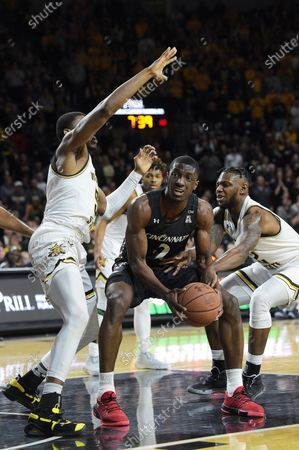 Stock Photo of Cincinnati Bearcats guard Keith Williams (2) is caught between a double team as he looks to score in the lane during the NCAA Basketball Game between the Cincinnati Bearcats and the Wichita State Shockers at Charles Koch Arena in Wichita,Kansas