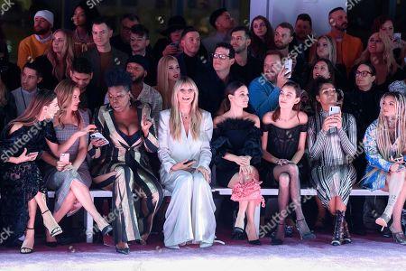 Angela Sarafyan, from left, Alicia Silverstone, Leslie Jones, Heidi Klum, Rachel Bilson, Alexa Chung, Indya Moore, and Zhavia Ward attend NYFW Fall/Winter 2020 - Christian Siriano at Spring Studios, in New York