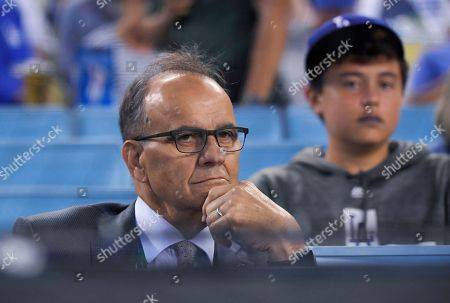 Joe Torre watches during the first inning of Game 1 in baseball's National League Divisional Series between the Los Angeles Dodgers and the Washington Nationals in Los Angeles. Major League Baseball will have a new disciplinarian. Torre, who has headed baseball operations at the commissioner's office since 2011, is shifting to a role as special assistant to the commissioner. Former pitcher Chris Young will replace Torre as the person who decides suspensions and fines for on-field matters, such as intentionally hitting batters, charging the mound and fights