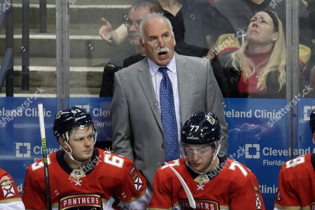 Florida Panthers head coach Joel Quenneville watches during the third period of an NHL hockey game against the Vegas Golden Knights, in Sunrise, Fla. The Golden Knights won 7-2