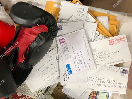 """A stack of fan mail for James """"Buster"""" Douglas, the former world heavyweight boxing champion, sits on a desk in Columbus, Ohio, where he teaches youth boxing. In one of the more spectacular upsets in sports history, Douglas defeated Mike Tyson, the reigning world heavyweight champion on Feb. 11, 1990, in Tokyo"""