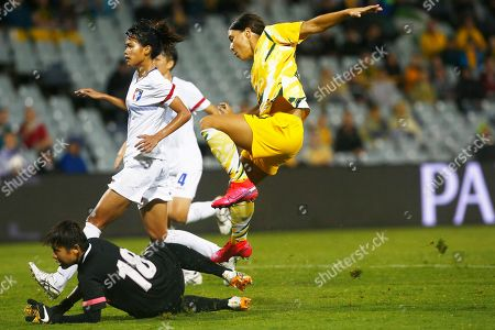 Samantha Kerr, right, of Australia scores a goal against Taiwan during their Olympic soccer qualifying match in Sydney