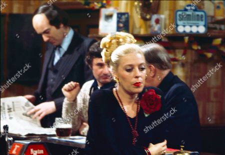 Roger Brierley (as Lanky Potts) and Julie Goodyear (as Bet Lynch)