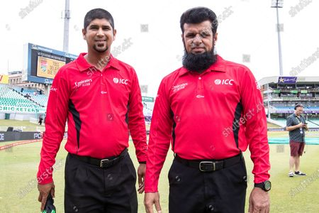 Stock Picture of Match officials Kumar Dharmasena & Aleem Dar inspect the pitch prior to the One Day International match between South Africa and England at Kingsmead CC, Durban