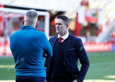 8th February 2020; Griffin Park, London, England; English Championship Football, Brentford FC versus Middlesbrough; Middlesbrough and Republic of Ireland Assistant Manager Robbie Keane talking to a member of the Middlesbrough coaching staff before kick off - Strictly Editorial Use Only. No use with unauthorized audio, video, data, fixture lists, club/league logos or 'live' services. Online in-match use limited to 120 images, no video emulation. No use in betting, games or single club/league/player publications