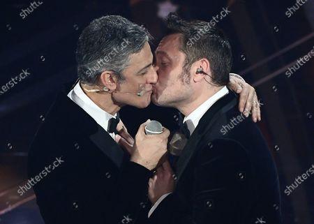 Italian showman Rosario Fiorello (L) and Italian singer Tiziano Ferro kiss on stage at the Ariston theatre during the 70th Sanremo Italian Song Festival, Sanremo, Italy, 07 February 2020. The festival runs from 04 to 08 February.