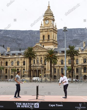 Roger Federer (R) of Switzerland and Rafael Nadal (L) of Spain play mini tennis on the Cape Town Grand Parade in front of the City Hall and Table Mountain ahead of their exhibition match in Cape Town, South Africa, 07 February 2020. Roger Federer will play Rafael Nadal in the Match in Africa Cape Town charity event at Cape Town Stadium on 07 February 2020. The Match in Africa is for the benefit of the Roger Federer foundation.