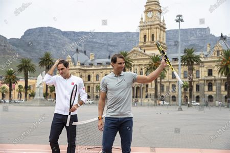 Roger Federer (L) of Switzerland and Rafael Nadal (R) of Spain react after playing mini tennis on the Cape Town Grand Parade in front of the City Hall and Table Mountain ahead of their exhibition match in Cape Town, South Africa, 07 February 2020. Roger Federer will play Rafael Nadal in the Match in Africa Cape Town charity event at Cape Town Stadium on 07 February 2020. The Match in Africa is for the benefit of the Roger Federer foundation.