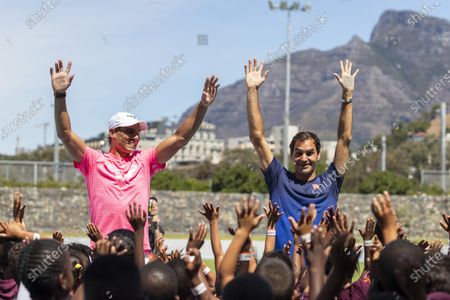 Roger Federer (R) of Switzerland and Rafael Nadal (L) of Spain take part in a Roger Federer Foundation Learning through Play session with South African children ahead of the Match in Africa charity event in Cape Town, South Africa, 07 February 2020. Roger Federer will play Rafael Nadal in the Match in Africa Cape Town charity event at Cape Town Stadium on 07 February 2020. The Match in Africa is for the benefit of the Roger Federer foundation.