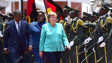 German Chancellor Angela Merkel (R) and Angola's President Joao Lourenco (L) walk together during a reception with military honors at the presidential palace in Luanda, South Africa, 07 February 2020. Merkel is on a three-day trip to South Africa and Angola.