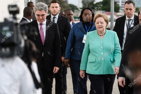 Stock Image of German Chancellor Angela Merkel (R) and Siemens CEO Joe Kaeser walk next to each other during a visit to a Siemens substation in Luanda, Angola, 07 February 2020. Merkel is on a three-day trip to South Africa and Angola.