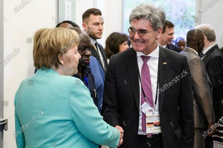 German Chancellor Angela Merkel (L) and Siemens CEO Joe Kaeser shake hands during a visit to a Siemens substation in Luanda, Angola, 07 February 2020. Merkel is on a three-day trip to South Africa and Angola.