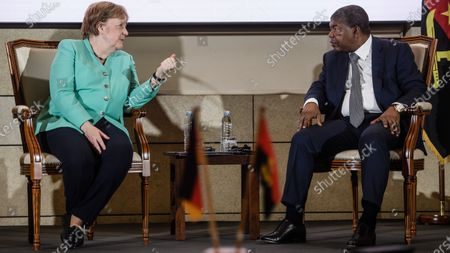 German Chancellor Angela Merkel (L) and Angola's President Joao Lourenco talk during a contract signing ceremony at the German-Angolan economy forum in Luanda, Angola, 07 February 2020. Merkel is on a three-day trip to South Africa and Angola.