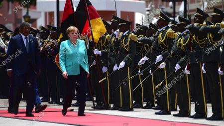 German Chancellor Angela Merkel (R) and Angola's President Joao Lourenco (L) inspect a guard of honor during a welcome ceremony at the presidential palace in Luanda, Angola, 07 February 2020. Merkel is on a three-day trip to South Africa and Angola.