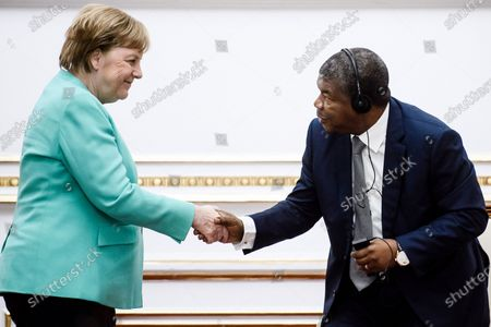 German Chancellor Angela Merkel (L) and Angola's President Joao Lourenco shake hands prior to a signing ceremony at the presidential palace in Luanda, Angola, 07 February 2020. Merkel is on a three-day trip to South Africa and Angola.