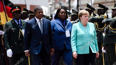 German Chancellor Angela Merkel (R) and Angola's President Joao Lourenco (2-L) walk next to each other during a reception with military honors at the presidential palace in Luanda, Angola, 07 February 2020. Merkel is on a three-day trip to South Africa and Angola.