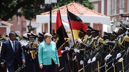 German Chancellor Angela Merkel (R) and Angola's President Joao Lourenco (L) walk next to each other during a reception with military honors at the presidential palace in Luanda, Angola, 07 February 2020. Merkel is on a three-day trip to South Africa and Angola.