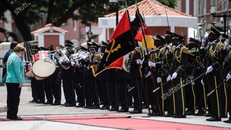 German Chancellor Angela Merkel (2-L) and Angola's President Joao Lourenco bow down their heads during a reception with military honors at the presidential palace in Luanda, Angola, 07 February 2020. Merkel is on a three-day trip to South Africa and Angola.