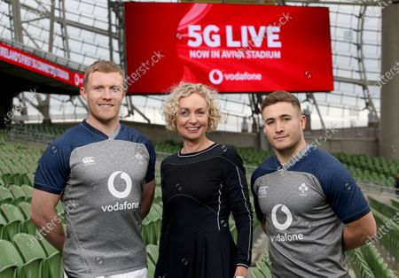 """The Aviva Stadium has become the first 5G-enabled sports facility in Ireland as Vodafone Ireland continues to expand its next generation network. Sports fans will benefit from Vodafone's game-changing mobile speeds which have the potential to create a unique in-stadium experience using virtual reality and augmented reality during live occasions. Additionally, the ultra-fast connectivity will offer players and management alike new possibilities for performance enhancement as more and more of the business of sport becomes digital first. Speaking about the opportunities 5G connectivity will bring to fans, players and management alike, Vodafone Ireland CEO Anne O'Leary said: """"Like all aspects of society, the world of sport is adapting and evolving through the use of digital technologies. The launch of 5G at the Aviva Stadium brings a new dimension to the principles of interactive sports on and off the field. Pictured today are Ireland players Keith Earls and Jordan Larmour with Ann O'Leary, Vodafone CEO"""