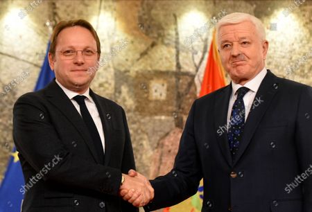 Montenegrin Prime Minister Dusko Markovic (R) and European Commissioner for Neighborhood Policy and Enlargement Negotiations Oliver Varhelyi (L) shake hands during a joint press conference following their meeting in Podgorica, Montenegro, 07 February 2020. Commissioner Varhelyi is in in Montenegro on a one-day official visit.