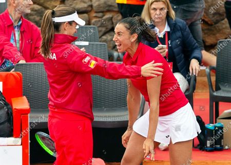 Spanish Fed Cup team player Sara Sorribes Tormo (R) celebrates with team captain Anabel Medina (L) after defeating Naomi Osaka of Japan during the Fed Cup playoff tie between Spain and Japan at La Manga tennis club in Atamaria, near Cartagena, southeastern Spain, 07 February 2020.