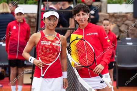 Japanese Fed Cup team player Misaki Doi (L) and Carla Suarez Navarro (R) of Spain line up during the Fed Cup playoff tie between Spain and Japan at La Manga tennis club in Atamaria, near Cartagena, southeastern Spain, 07 February 2020.