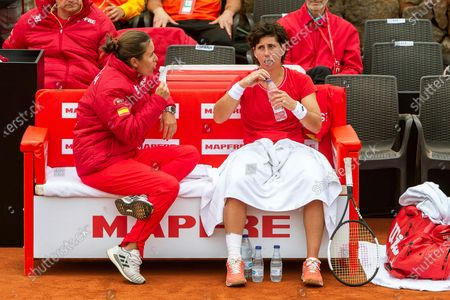 Spanish Fed Cup team player Carla Suarez Navarro (R) listens to team captain Anabel Medina (L) during a break in her match against Misaki Doi of Japan at the Fed Cup playoff tie between Spain and Japan at La Manga tennis club in Atamaria, near Cartagena, southeastern Spain, 07 February 2020.