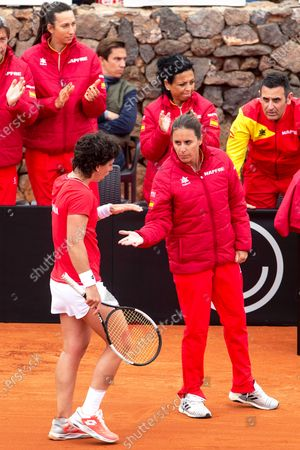 Spanish Fed Cup team player Carla Suarez Navarro (L) reacts next to team captain Anabel Medina (R) during her match against Misaki Doi of Japan at the Fed Cup playoff tie between Spain and Japan at La Manga tennis club in Atamaria, near Cartagena, southeastern Spain, 07 February 2020.