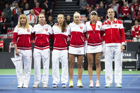 Swiss Fed Cup team players (L-R) Timea Bacsinszky, Stefanie Voegele, Viktorija Golubic, Jil Teichmann, Belinda Bencic, and team captain Heinz Guenthardt line up for the Fed Cup playoff tie between Switzerland and Canada at the Swiss Tennis Arena in Biel, Switzerland, 07 February 2020.