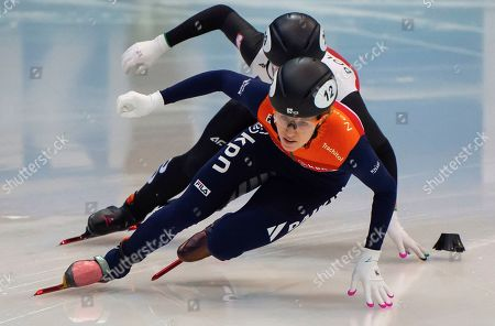 Rianne de Vries of Netherlands, front, competes at the ladies 500 meters qualification race during the World Cup short track speed skating championship in Dresden, eastern Germany, . The ISU World Cup runs from Feb. 7 to Feb. 9. 2020