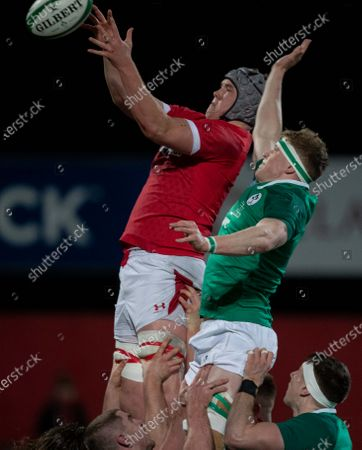 Stock Photo of Ireland U20 vs Wales U20. Ireland's Sean O'Brien with Jac Price of Wales