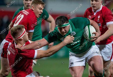 Ireland U20 vs Wales U20. Ireland's Thomas Clarkson with Ben Carter of Wales