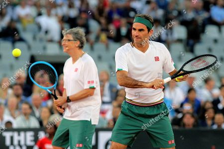 Roger Federer and Bill Gates take on Rafael Nadal and Trevor Noah in the exhibition match held at the Cape Town Stadium in Cape Town, South Africa