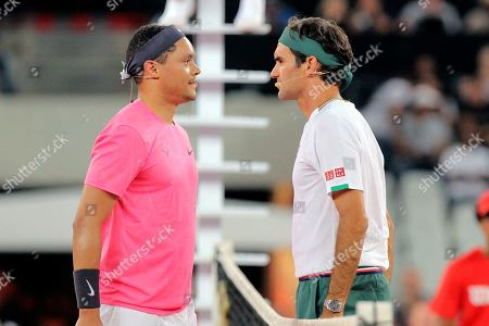 Trevor Noah and Roger Federer face off before the exhibition match held at the Cape Town Stadium in Cape Town, South Africa