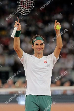 Roger Federer waves at the crowd during the exhibition tennis match against Rafael Nadal held at the Cape Town Stadium in Cape Town, South Africa