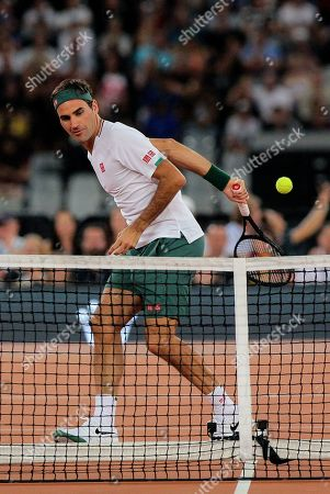 Roger Federer in action during the exhibition tennis match against Rafael Nadal held at the Cape Town Stadium in Cape Town, South Africa