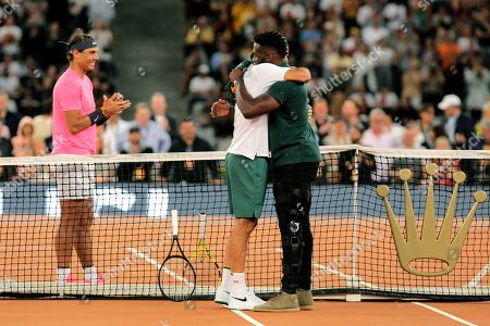 Springbok Captain Siya Kolisi, right, greets Roger Federer while Rafael Nadal looks on ahead of their exhibition tennis match held at the Cape Town Stadium in Cape Town, South Africa