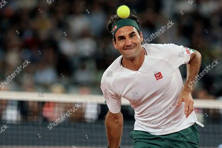 Stock Photo of Roger Federer in action during the exhibition tennis match against Rafael Nadal held at the Cape Town Stadium in Cape Town, South Africa