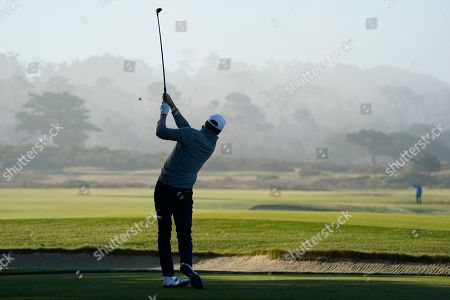 Eli Manning follows his drive from the 12th tee of the Monterey Peninsula Country Club Shore Course during the second round of the AT&T Pebble Beach National Pro-Am golf tournament, in Pebble Beach, Calif
