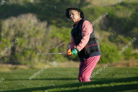 Bill Murray follows his chip shot to the 10th green of the Monterey Peninsula Country Club Shore Course during the second round of the AT&T Pebble Beach National Pro-Am golf tournament, in Pebble Beach, Calif