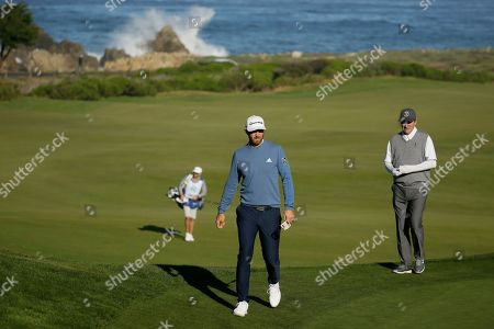 Stock Photo of Dustin Johnson, Wayne Gretzky. Dustin Johnson, left, and Wayne Gretzky walk up to the 10th green of the Monterey Peninsula Country Club Shore Course during the second round of the AT&T Pebble Beach National Pro-Am golf tournament, in Pebble Beach, Calif