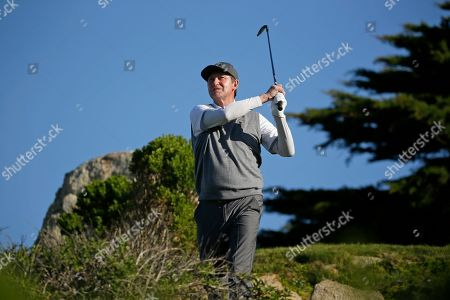 Wayne Gretzky follows his shot from the 11th tee of the Monterey Peninsula Country Club Shore Course during the second round of the AT&T Pebble Beach National Pro-Am golf tournament, in Pebble Beach, Calif