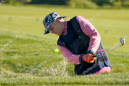Bill Murray hits out of the bunker on the 11th green of the Monterey Peninsula County Club Shore Course during the second round of the AT&T Pebble Beach National Pro-Am golf tournament, in Pebble Beach, Calif