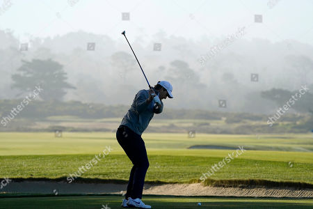 Stock Image of Eli Manning hits from the 12th tee of the Monterey Peninsula County Club Shore Course during the second round of the AT&T Pebble Beach National Pro-Am golf tournament, in Pebble Beach, Calif