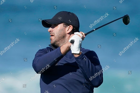 Tony Romo follows his shot from the 13th tee of the Monterey Peninsula County Club Shore Course during the second round of the AT&T Pebble Beach National Pro-Am golf tournament, in Pebble Beach, Calif